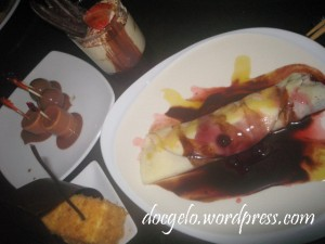 mallows & grapes dipped in chocolate fountain, cheesecake and berries & mangoes crepe