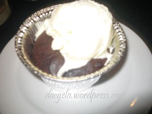 chocolate mud pie topped with vanilla ice cream from Tosca