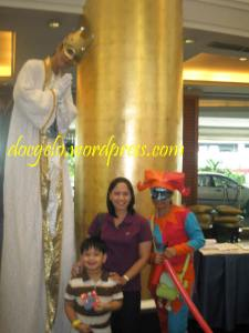 My wife Tina & our son Gabby with the carnival people of Dusit Thani