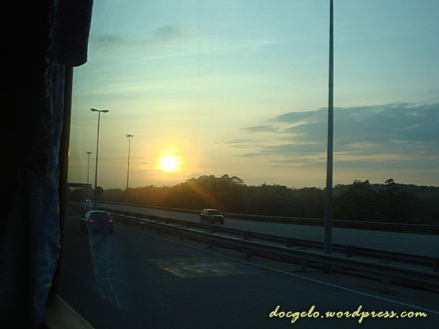 sunrise viewed from a bus