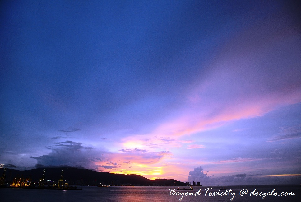 sunset viewed from the tiny porch of our 11th floor appartment in penang, malaysia